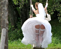 Wind shows brides sexy upskirt